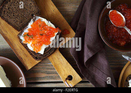 Sandwich with caviar on the board, food - Stock Photo
