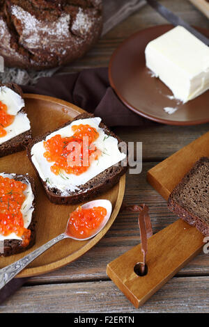 Sandwich with caviar and butter on a plate, top view - Stock Photo