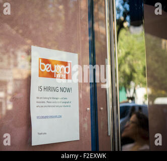 A sign in the window of soon to be opened vaporium in New York advises potential job applicants of the opportunities - Stock Photo
