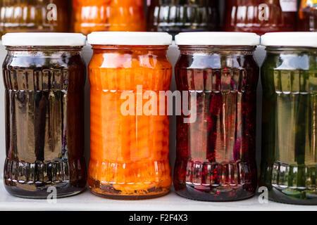 Jars of tasty jam on market. Homemade sale. - Stock Photo