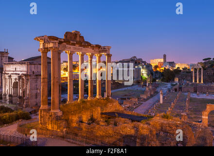 The columns are the ruins of The Temple of Saturn, a temple to the god Saturn in the Roman Forum  Rome Lazio  Italy - Stock Photo