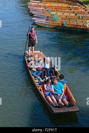 Tourists on a punt trip along the River Cam viewed from the Garret Hostel Bridge, The Backs, Cambridge, England, - Stock Photo