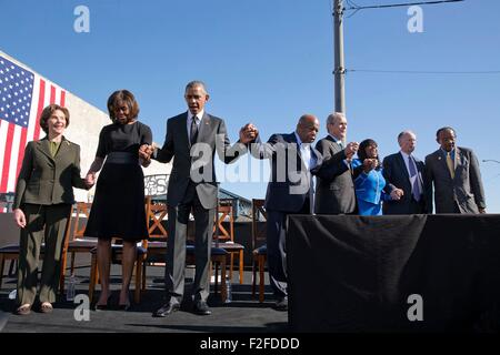 U.S. President Barack Obama holds hands with civil rights legend and Congressmen Rep. John Lewis and First Lady - Stock Photo