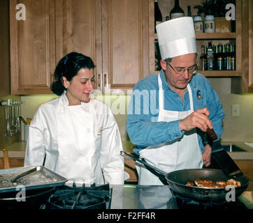 American travel journalist, broadcaster and television personality Joseph Rosendo gets some cooking tips at the - Stock Photo