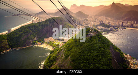 Cable car approaching Sugarloaf Mountain, Urca, Rio de Janeiro, Brazil - Stock Photo