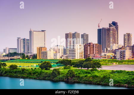 Kawasaki, Japan skyline on the Tamagawa River. - Stock Photo