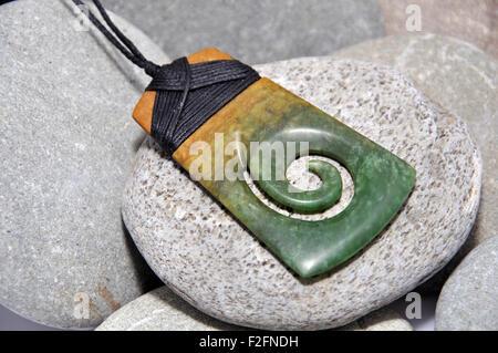jade adze pendant made from Westland pounamu, West Coast, South Island, New Zealand - Stock Photo