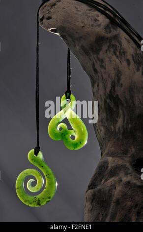 Backlit jade pendants made from Westland pounamu, West Coast, South Island, New Zealand - Stock Photo