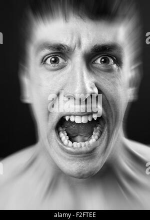 Loud scream of scared frighten young man - Stock Photo