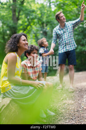 Family bird watching in woods - Stock Photo
