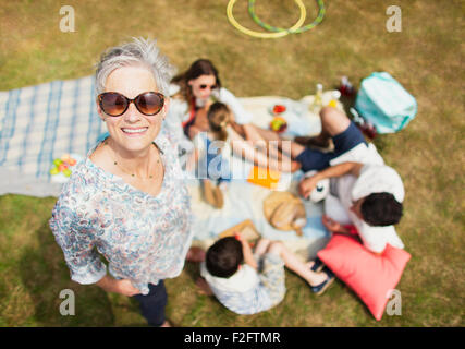 Portrait smiling senior woman with family at picnic - Stock Photo