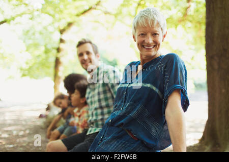 Portrait smiling multi-generation family in woods - Stock Photo