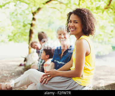 Portrait laughing multi-generation family in woods - Stock Photo