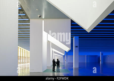 Skylight Columns And Ground Floor Gallery In Blue Light With Silhouetted  Figures. Museu Del Disseny