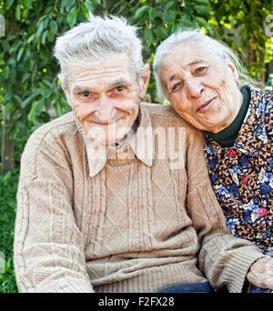 Happy and joyful old senior couple outdoor - Stock Photo