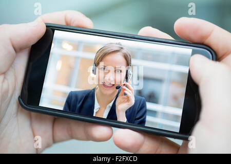 Businesswoman chatting with smart phone - Stock Photo