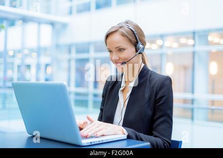 Operator talking on microphone - Stock Photo