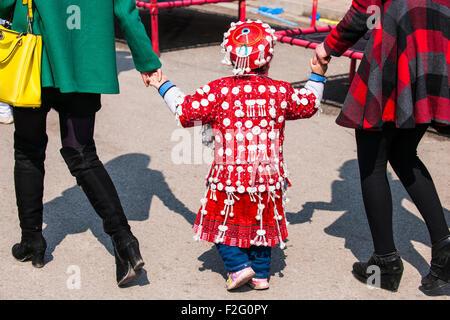 Little girl wearing traditional Miao festival costume, Guizhou, China - Stock Photo
