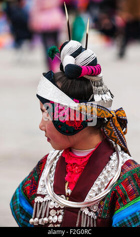 Miao woman in traditional costume and silver jewellery at the Lusheng festival, Zhouxi, Guizhou, China - Stock Photo