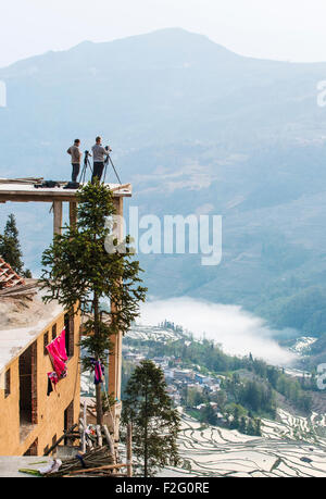 Photographers taking pictures of the rice terraces in Yuanyang, Yunnan, China - Stock Photo