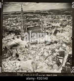 Aerial photograph of the German city of Ulm taken after the devastating air raid of December 1944, showing the huge destruction caused by Allied bombing yet leaving the church, Ulm Minster, largely intact. Most of the city's medieval centre was destroyed by the bombing. The church, also known as Ulm Cathedral, Ulm Münster or Ulmer Münster has the tallest spire of any church in the world (161.5m). The church was built between approximately 1400 and 1540, though the steeples were not completed until 1890.