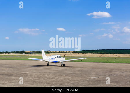 Piper PA-28-161 Cherokee Warrior II waiting for take-off clearance at Duxford aerodrome, Cambridgeshire, England, - Stock Photo