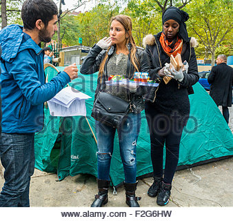 Paris, France. Group of French Volunteers serving food in Camp of Syrian Refugees, Migrants, at 'Port de Saint Ouen' - Stock Photo