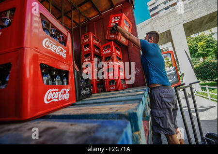 the delivery of Coca Cola-la entrega de Coca Cola - Stock Photo
