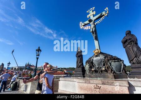 Charles Bridge, Statue Of Jesus On The Cross, Prague, Czech Republic, Europe - Stock Photo