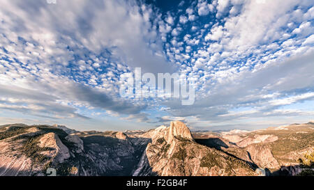 Beautiful sky over Half Dome mountain, Yosemite National Park at sunset, California, USA. - Stock Photo