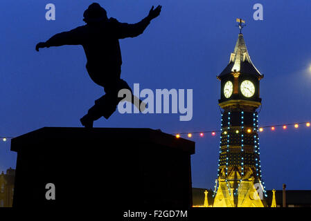Clock Tower and the Jolly Fisherman statue at night. Skegness. Lincolnshire. England. UK - Stock Photo