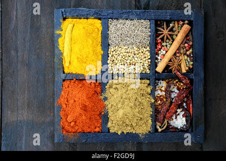 Indian spices on wooden background - Stock Photo