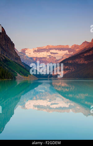 Glacial Lake Louise with Victoria glacier and mountains reflected in emerald water, Banff National Park, Alberta, - Stock Photo