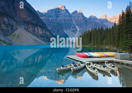 Canoes at Moraine Lake in the Valley of the Ten Peaks, Banff National Park, Alberta, Canada - Stock Photo