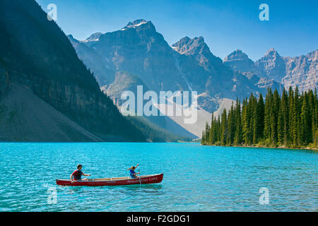 Tourists in canoe on Moraine Lake in the Valley of the Ten Peaks, Banff National Park, Alberta, Canada - Stock Photo