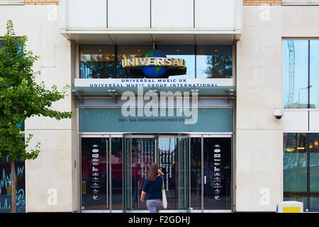 LONDON, UK - AUGUST 17: Woman approaching entrance of Universal Music Group International building in High Street - Stock Photo