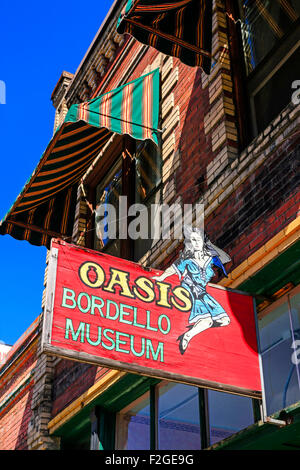 Overhead sign for the Oasis Bordello museum in the historic city of Wallace, set in the Silver Valley mining district - Stock Photo