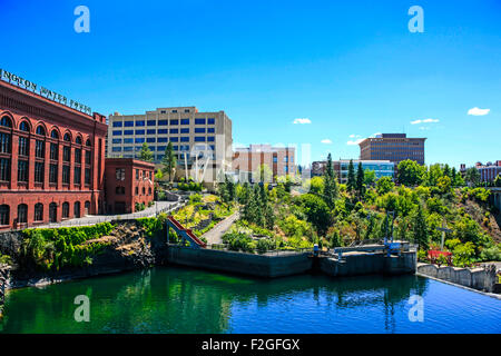 View of the riverfront buildings and Skyride over the Spokane River in Spokane, Washington - Stock Photo
