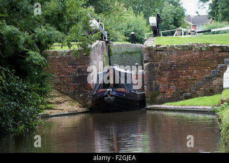 Narrow boat leaving lock near Penkridge. Staffordshire and Worcestershire Canal. UK - Stock Photo