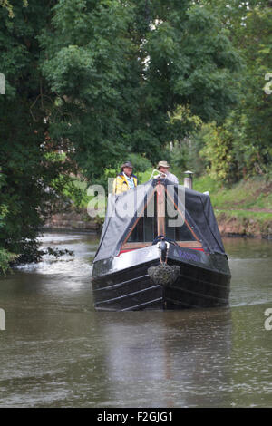 Barge in the rain , on the Staffordshire and Worcestershire Canal near Penkridge. UK - Stock Photo