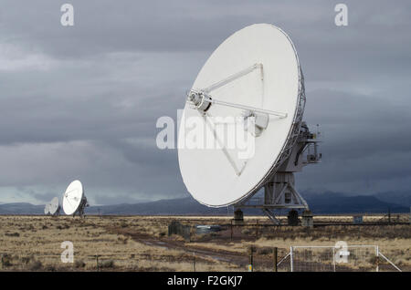 A row of antennae at the VLA (Very Large Array) aka Karl G. Jansky VLA located 50 miles west of Socorro, New Mexico - Stock Photo