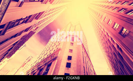 Vintage filtered photo of skyscrapers in Manhattan at sunset, New York City, USA. - Stock Photo