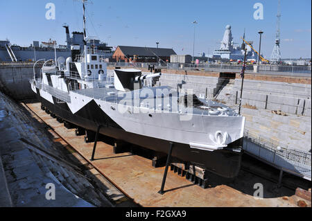 Portsmouth Historic Dockyard UK - HMS M.33 monitor the last remaining warship from WW1 which fought in Dardanelles - Stock Photo