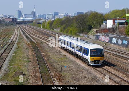 Chiltern Railways 165014 heads through Small Heath Birmingham with a Moor Street - London Marlybone service on 23/04/15. - Stock Photo