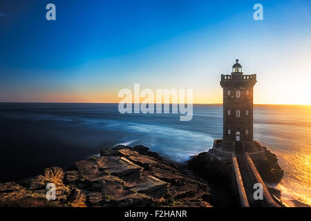 Kermorvan Lighthouse before sunset, Brittany, France - Stock Photo