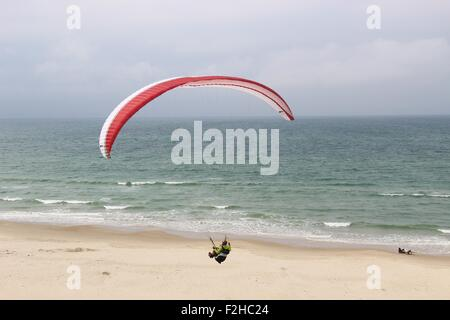 Paragliding on the coast of Denmark, Europe. North Jutland. - Stock Photo