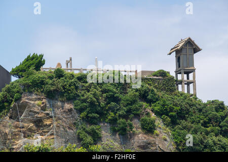 Remains of Hashima Shrine of Gunkanjima (Hashima) in Nagasaki, Japan - Stock Photo