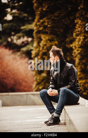Confident man posing in selvedge  jeans - Stock Photo