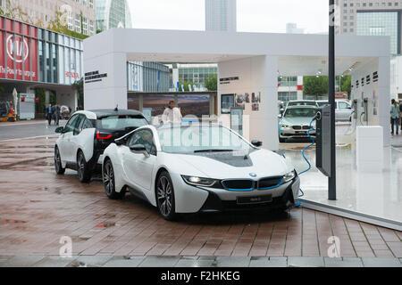 Frankfurt international motor show (IAA) 2015. Plug-in hybrid model BMW I8 on charging station - Stock Photo