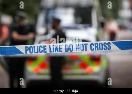 Police crime scene tape UK - Stock Photo